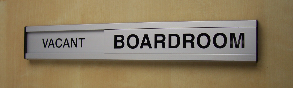 Prevent disruptions to meetings with a sliding door sign...